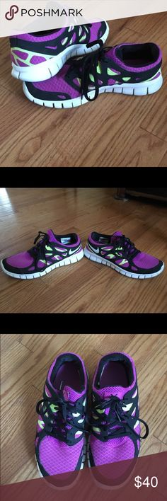 Purple and Green Nike Free Run 2 Purple and Green Nike Free Run 2, women's size 9, very comfortable, normal wear and tear on the bottom of the shoes. Perfect for running! Nike Shoes Athletic Shoes