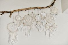 We love the idea of hanging a dreamcatcher over the bed, only letting good dreams filter through while catching all the bad dreams in the net. Plus, let's admit it, they fit perfectly with our boho ae