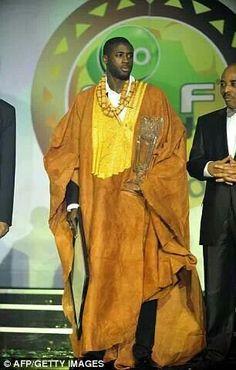 Yaya toure receiving an award
