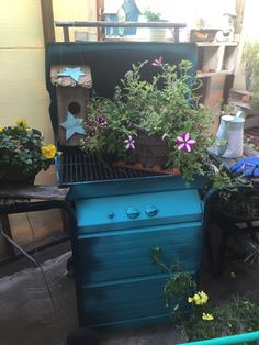 Potting bench made out of old BBQ.  Take off grate and fill belly with potting soil.