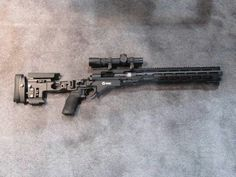 The rifle is a Remington 700 chambered in .300 AAC BLK. It features the fancy new Remington folding RACS stock (Remington Arms Chassis System) and an integrally suppressed barrel. The optic is sport is very nifty. It has a custom Leupold scope that features a custom front focal recticle ballistically matched to the subsonic .330 AAC BLK and the supersonic .300 AAC BLK.