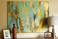 Herringbone Metallic Artwork: Easy & Cheap! Paint random blobs of paint in up and down direction, do the same with metallic spray paint, then tape a herringbone pattern with wide tape, leaving small spaces between the stripes. Paint over with metallic paint and remove tape. Voila! Gorgeous!