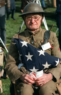 #military #veterans todaysdocument:   Joseph Ambrose, an 86-year-old World War I veteran, watches the dedication day parade for the Vietnam Veterans Memorial, 11/13/1982.  He is holding the flag that covered the casket of his son, who was killed in the Korean War. - @ www.HireAVeteran.com