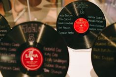 Vinyl Record Seating Chart Display - NC Wedding Planner - Full story found at: www.orangerieeven... & Photography by Perry Vaile Photography