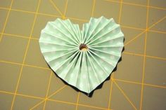 Most of us have created accordion flowers of varying shapes at some point and Christa gave us a great Freindzy Friday recently for one variety, but I quite often use accordion hearts on cards and scrapbook pages, to add a 'heartfelt' variation to this popular embellishment.