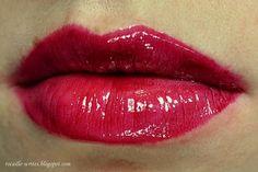 NYX Mega Shine Lip Gloss in Garnet (LG139): dark cool-toned raspberry, cream finish