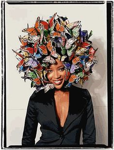 A butterfly hat is by Philip Tracey