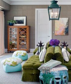 Create a dynamic seating arrangement by placing a set of sofas in the center of the room and with their backs to each other.
