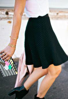 black mini skirt and stripe clutch