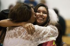 Karlys Swan, left, proudly kisses her daughter Wicahpi Bison on the cheek after she received her feather Wednesday during a feathering and honoring ceremony at Rapid City Stevens High School. Check out our other photos from the ceremony! #graduation #featheringceremony #RapidCity