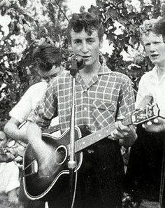 July 6 1957 - John Lennon and Paul McCartney of the Beatles are introduced to each other when Lennon's band the Quarrymen performs at the St. Peter's Church Hall