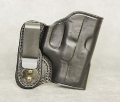 Inside the Waistband Leather Holster for Glock 27. Holster comes in black or brown and has ambidextrous capability (left or right hand draw). The clip can be removed and placed on the opposite side of the holster for left hand draw or small of back carry. $54.99 #holster #concealedcarry #IWB #Glock #Glock27 Concealed Handgun, Concealed Carry, Home Protection, Leather Holster, Holsters, 2nd Amendment, Hand Guns, How To Draw Hands, Wallet