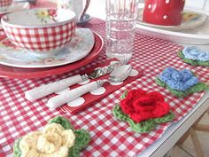 Cath Kidston look. Love the dishes, runner & crochet!