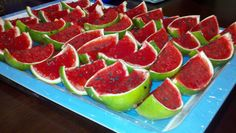 4th of July watermelon jello shots... strawberry jello, watermelon vodka and lime juice in hulled limes with black sesame seeds.
