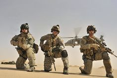 U.S. Air Force pararescuemen Corey Farr (right), Jeremy Diola (center), Michael Fleming of the 66th Expeditionary Rescue Squadron pull security after exiting an HH-60G Pave Hawk during an operational training exercise in Iraq on Sept. 19, 2008