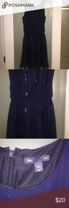 GAP Navy Blue Dress with Sequin Waist This dark navy blue chiffon overlay dress with some sequins horizontally placed around the elastic waist is very flattering! GAP Dresses