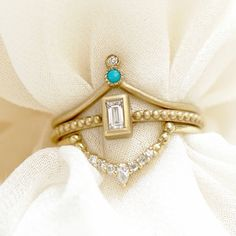 Eclectic in all of the right ways, the Shereen Stack is easily one of our favorite combos! A pop of turquoise, beaded textures and a happy mix of diamond cuts come together in a chic and effortless alternative engagement ring stack.