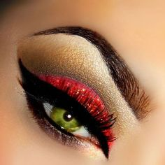 Red glitter with bold black liner.  It's so stunning with her eye coloring.