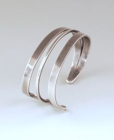 "Cuff | Paul Lobel ""Triple Bar"" Sterling silver."