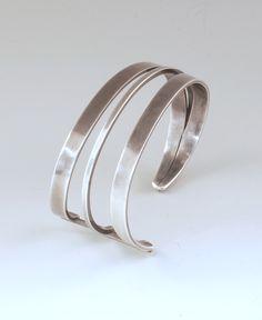 "Cuff | Paul Lobel ""Triple Bar""  Sterling silver."