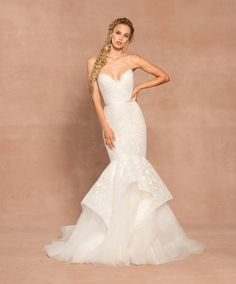 Style 62004 Nelson Hayley Paige bridal gown - Ivory eyelet organza fit to flare gown, strapless scalloped sweetheart neckline and cut-out corset back, elongated bodice with tiered eyelet skirt and tulle underlay. Shown with matching Eyelet veil.