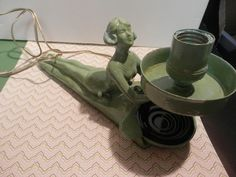 "Art Deco 1930""s Nude Lady Lamp Ash Tray Green Patina Works by auntsalsgals on Etsy https://www.etsy.com/listing/523597831/art-deco-1930s-nude-lady-lamp-ash-tray"