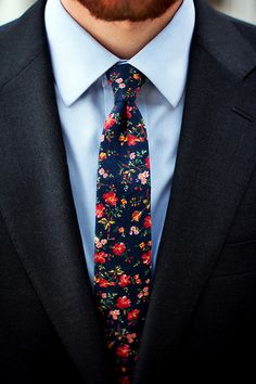Mix a floral/patterned tie with a classic navy suit and light blue dress shirt. The traditional suit and matching tie base balance out any print on the tie.