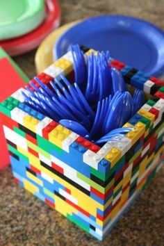 Lego utensil holder. Just one of many ideas for a great Lego birthday party. Cakes, games, decorations, party favors.