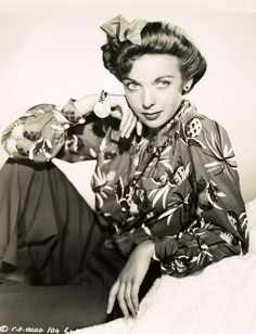 Ida Lupino, 1941, wearing a  tropical print shirt with pineapples and palm trees