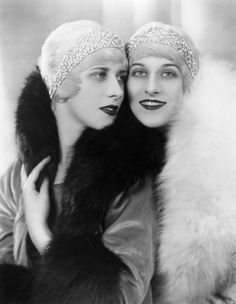 1920's Fashion - The Rowe Sisters wearing jewelled headbands and fur collars, 1928 - Photo by Sasha - Getty Images
