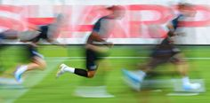 Members of the English national soccer team warm up at practice in Donetsk, Ukraine, on the eve of their Euro 2012 opener against France.