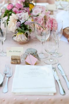 I love the pink linen, the wine cork place card holder and the jam jar as a favor for guests