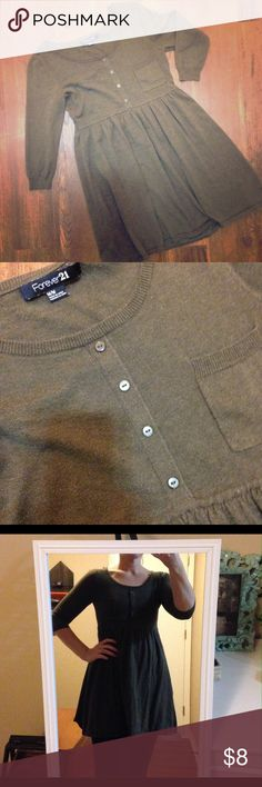 Forever 21 sweater This dark olive sweater features an empire waist and decorative photo buttons.  Pairs perfect with leggings and boots! Excellent condition! Thanks for looking! Forever 21 Sweaters