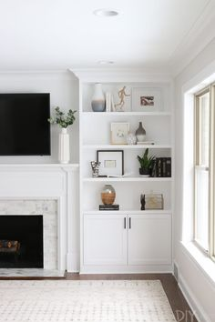Home Decor Recibidor all white living room design // white built in shelves // hardwood floors // white rug // fireplace.Home Decor Recibidor all white living room design // white built in shelves // hardwood floors // white rug // fireplace Bookshelves Around Fireplace, Built In Around Fireplace, Fireplace Built Ins, Home Fireplace, Bookshelves Built In, Living Room With Fireplace, Tv Built In, Bookshelf Wall, Bookshelf Ideas