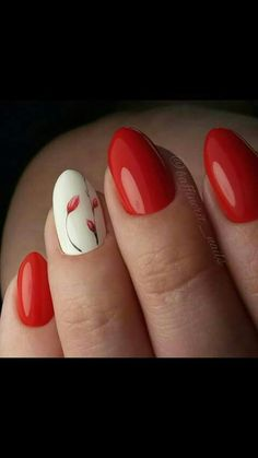 Red nails and one nail white with an artistic flower.