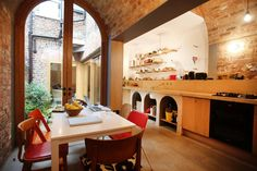 The kitchen extension has a concrete worktop set on arches that mirror the barrel-vaulted roof