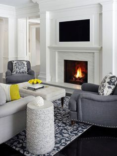 Here's everything you need to know about placing a TV over a fireplace in your home. We're showing you different ways you can do so in your living room so that your cable box and cords are not showing.