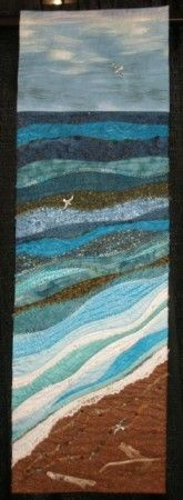 Nice beach scene/ I n eed to do this type of quilt and use part of the old family quilt in the water pieces! <3