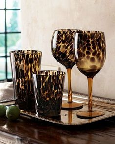 Four Tortoise Balloon Glasses by Horchow. $34.90. Glowing color and patterns drawn from nature and portrayed in glass add exotic flair to table settings. Shown left to right: Highball holds 19.5 ounces. Double old-fashioned holds 12.5 ounces. Balloon glass holds 17 ounces. Wine goblet holds 14 oun...