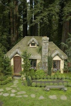 a green cottage. if the windows were round it would remind me of a Hobbit House! Looks like a miniature-made cottage.