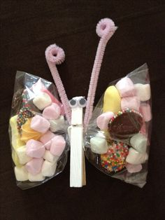 lolly bags: great fine motor activity too...children can use tongs to select what they want for their bag and put it in the bag.