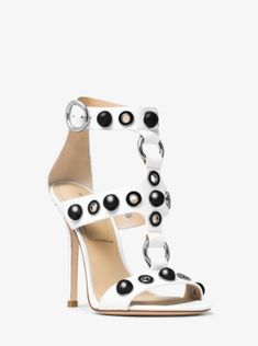 Gleaming metal accents make a statement on the Arlene sandal. This strappy style is crafted in Italy from the finest leather. An adjustable ankle strap and stiletto heel complete this glamorous design.
