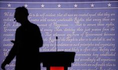 A producer walks past the stage set for the presidential debate between Hillary Clinton and Donald Trump at Hofstra University.