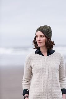 Rhythmic all-over cables in Shelter produce a handsome, seaworthy cap that's quick and satisfying to knit. After a short band of 1 x 1 rib, the hat breaks into a geometric motif of interlocking tiered cables. Perfect for knitters who have tried some basic cables and feel ready for more challenge, the charts are predictable and easy to memorize. The pattern includes a modification for a slightly shorter beanie length.