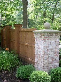 Not my favorite, but nice combo of brick and wood. Nice privacy with this fence. Pretty lush landscaping.