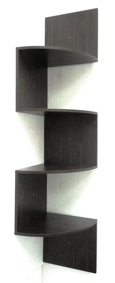 Modern Staggering Corner Bookshelf in - envision it in light birch or maple, floating above floor up to ceiling.