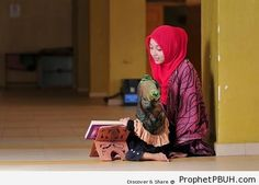 Muslim Woman Teaches Her Little Sister Quran - Mushaf Photos (Books of Quran)