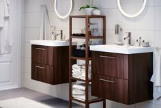 Make the skinny bathroom feel open.  The open shelves would work well too. IKEA Sink cabinets
