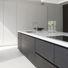 I like the contrast between the wood veneer and the white cabinets in the background.