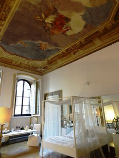 Our Frescoed ceiling room at Palazzo Tolomei in Florence